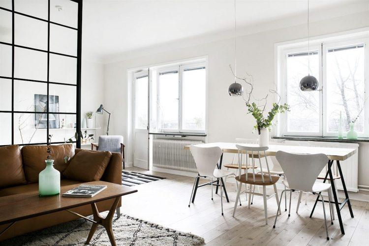 Sala y comedor con decoración escandinava basada en el uso de pocos muebles pero con detalles únicos
