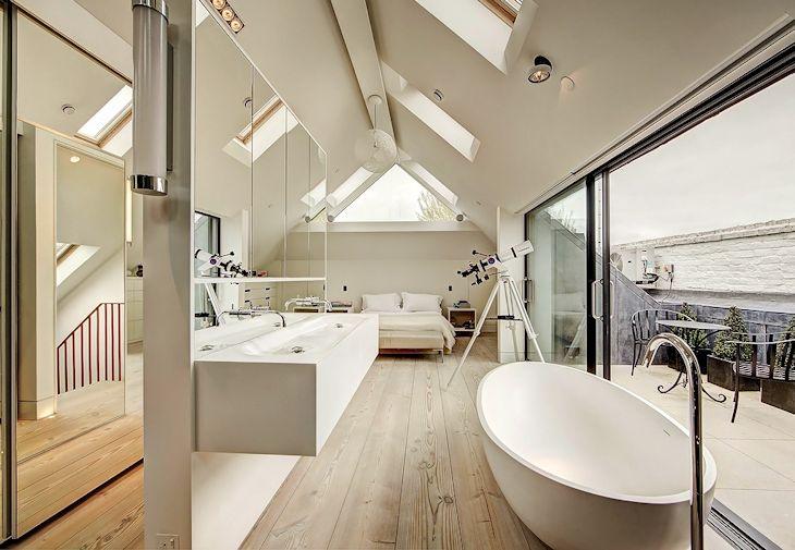 Cuarto de baño de diseño minimalista integrado al dormitorio