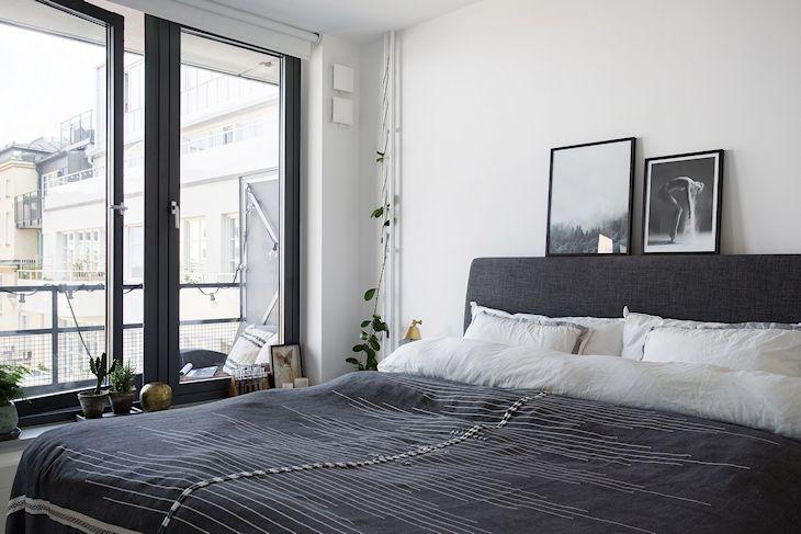 Dormitorio con decoración masculina basada en el gris y el blanco