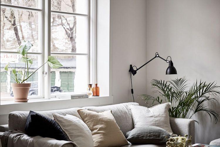 Las lámparas de pared son un buen recurso para iluminar sin ocupar espacio