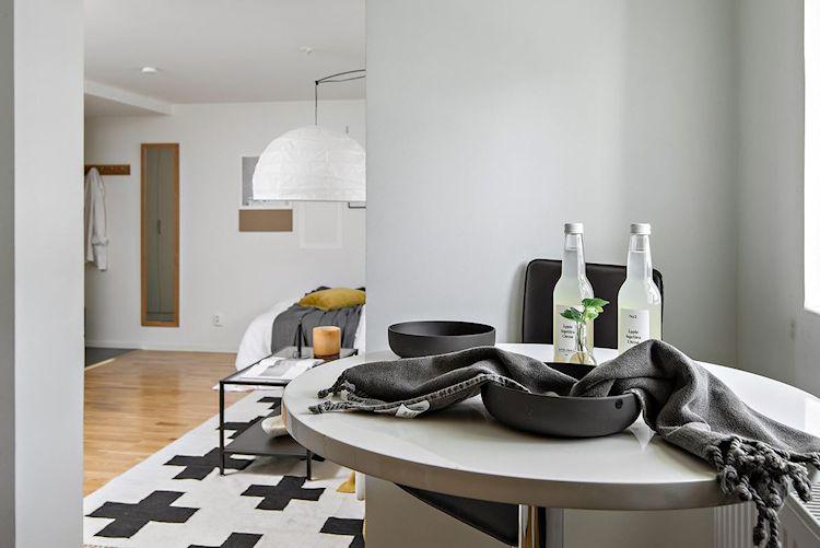 Decoración estudio departamento minimalista de 33 metros² 6