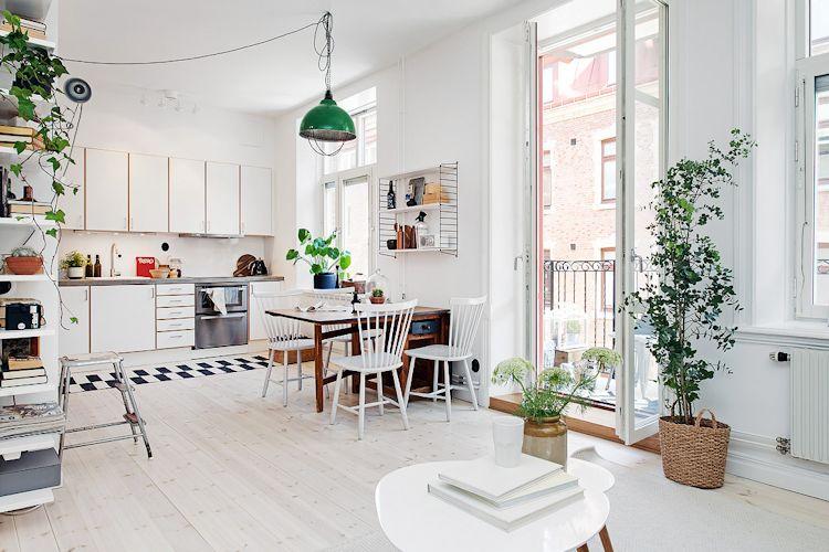 Cocina, comedor y sala integradas en un único espacio