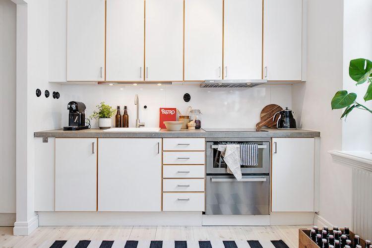 Cocina pequeña con encimera de concreto pulido