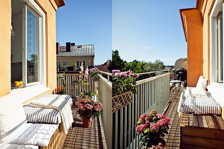 Muebles económicos para la terraza, creados con maderas con espacio de guardado debajo