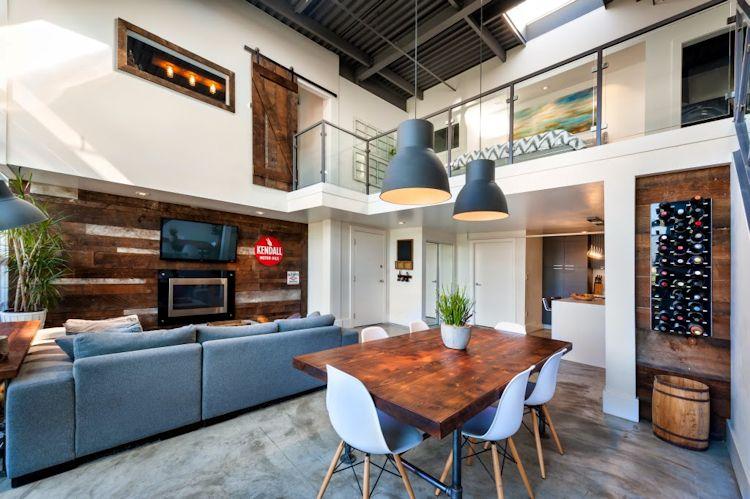 Antiguo granero convertido en loft estilo industrial rústico